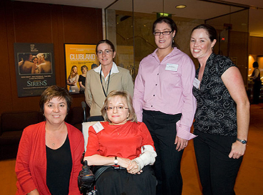 photo of Julie McCrossin and group at the Capacity Toolkit launch